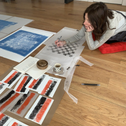 Belgin Yucelen in her studio during printmaking